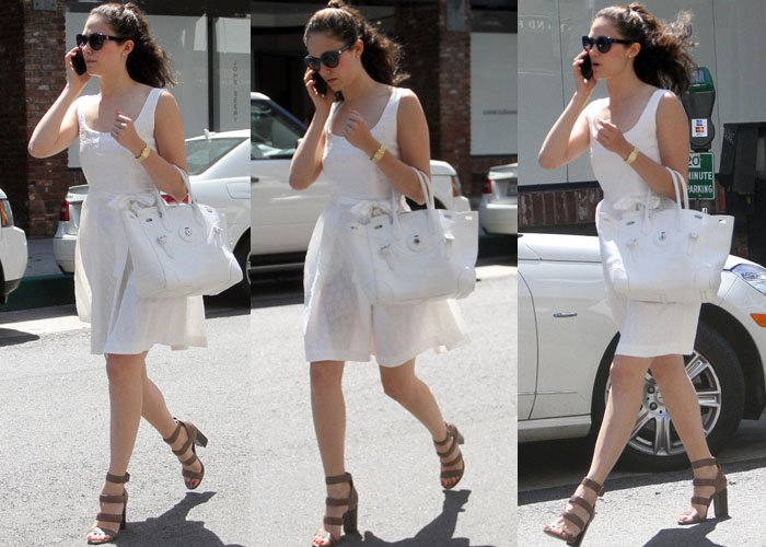 Emmy Rossum flaunted her legs in a summery white dress