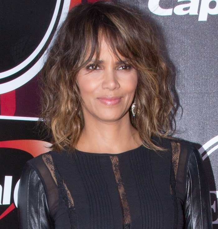 Halle Berryin a long-sleeved leather and lace dress from the Teresa Helbig Fall 2012 collection