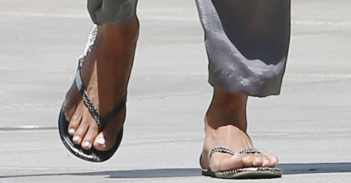 Halle Berry showed off her feet in reptile print flip-flops from TKEES