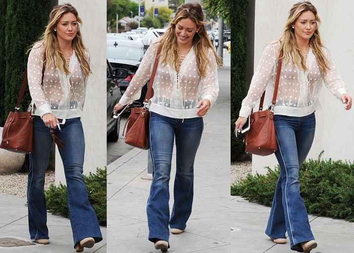 Hilary Duff styled flared jeans with a sheer top from Iro and a lace bra