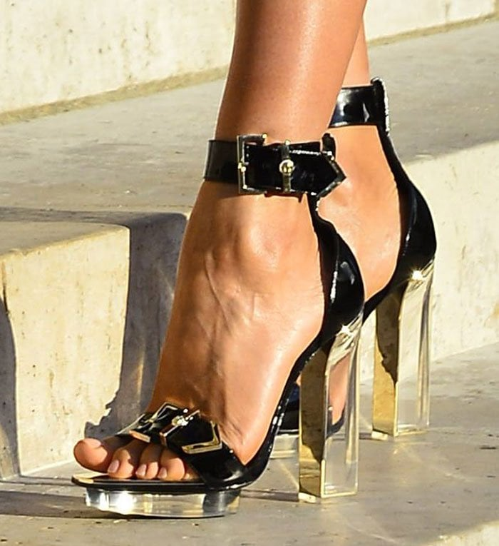Irina Shayk's pretty feet in chunky transparent Plexi heels