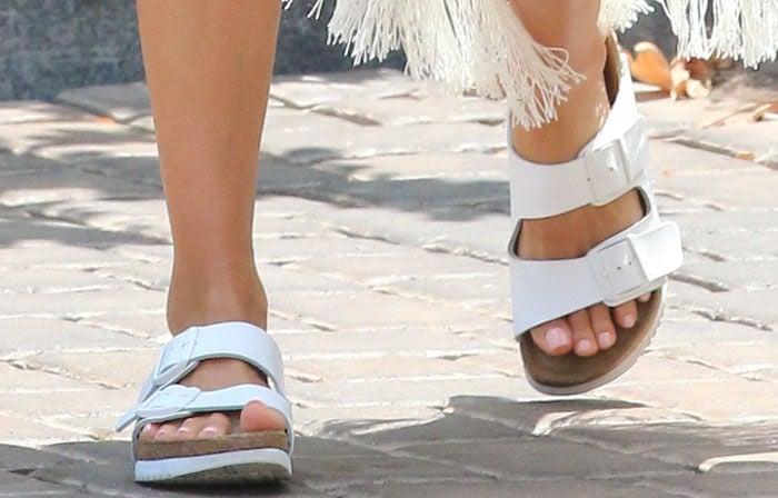 Jessica Alba shows off her feet inwhite contoured sandals from Birkenstock
