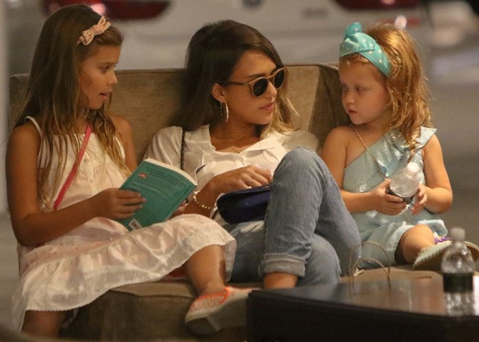 Jessica Alba cozies up on a chair with her two daughters
