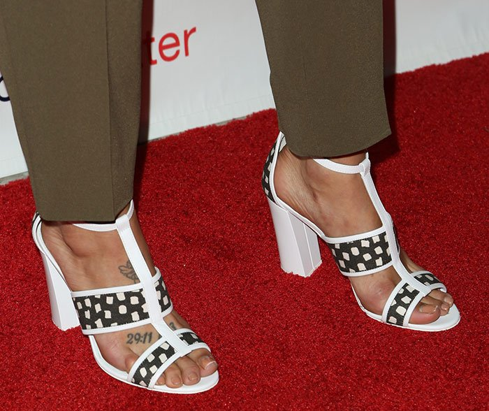 Jessica Szohr's toes on display in micro-square pattern sandals