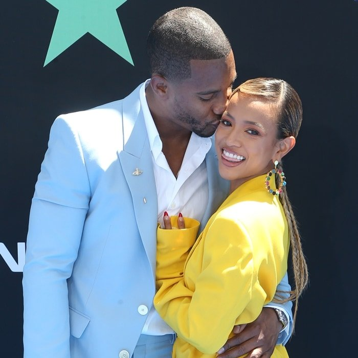 Karrueche Tran gets a kiss from Super Bowl XLVI champion Victor Cruz