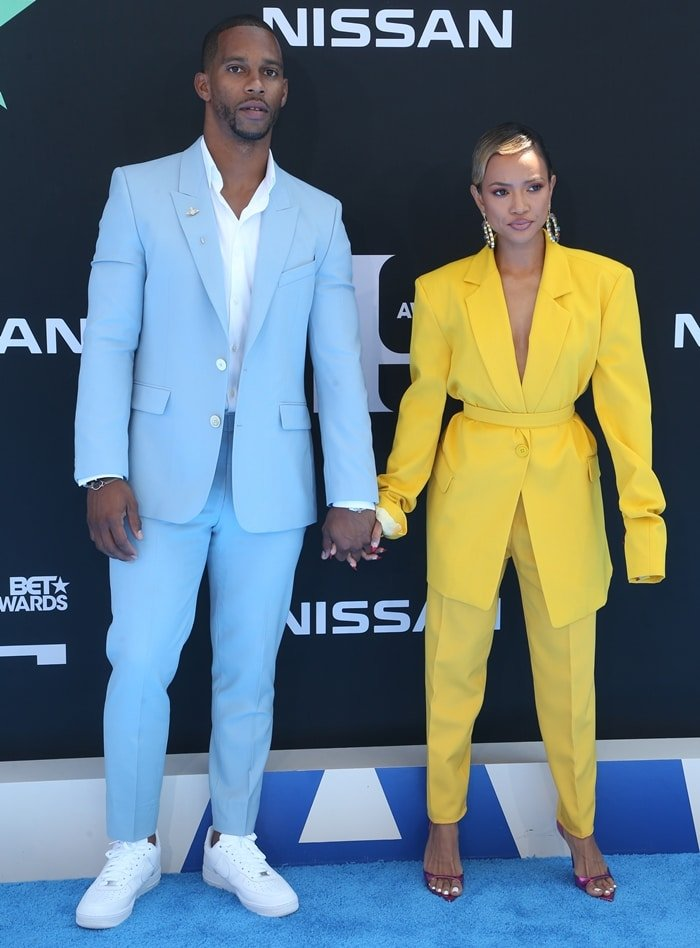 Karrueche Tran and Victor Cruz hold hands at the 2019 BET Awards