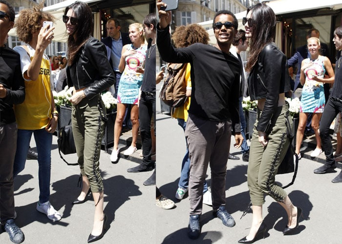 Kendall Jenner makes a stop at a Chanel boutique in Paris while showing off her toned midriff on July 6, 2015