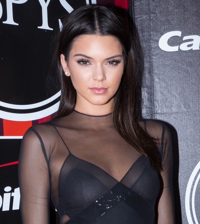 Kendall Jenner shows off her center part and dramatic eye makeup at the ESPY Awards