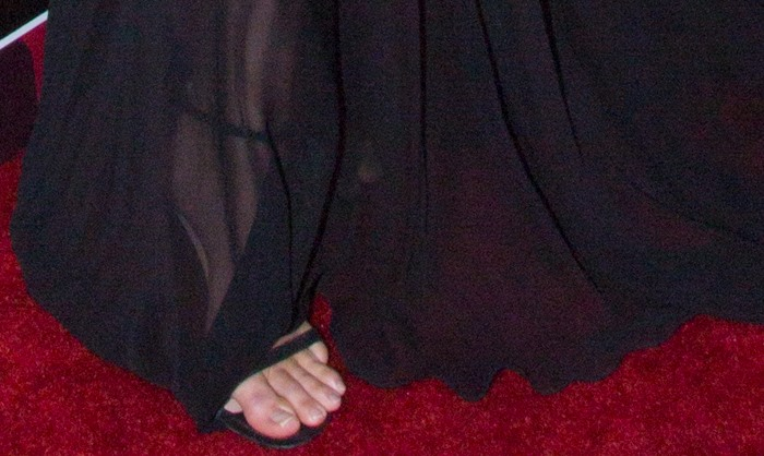"""Kendall Jenner's unpainted toenails peek out from the open-toed design of her Stuart Weitzman """"Nudist"""" sandals"""