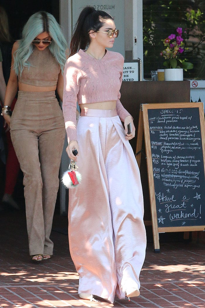 Sisters Kendall and Kylie Jenner leaving after having lunch at Mauro's Cafe in West Hollywood, California, on July 10, 2015