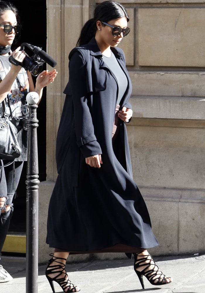 Kim Kardashian changes into her second outfit for the day while going around Paris on July 21, 2015