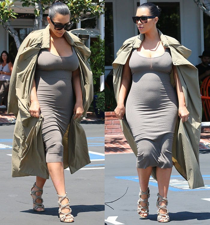 Kim squeezed her voluminous figure into a gray skin-tight ribbed dress