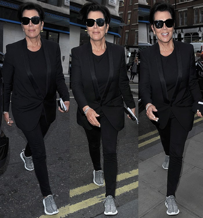 Reality star Kris Jenner hides her eyes behind a pair of dark shades as she leaves a London fashion shoot