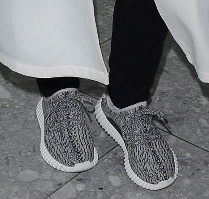Kris Jenner shows off the detail of the Yeezy Boost 350 sneakers by Kanye West