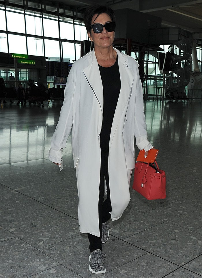 Kris Jenner rocks a neutral-and-red look as she arrives at Heathrow Airport in London, England, on July 14, 2015