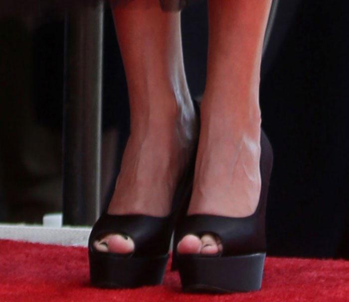 Kristin Chenoweth wearing black peep-toe pumps