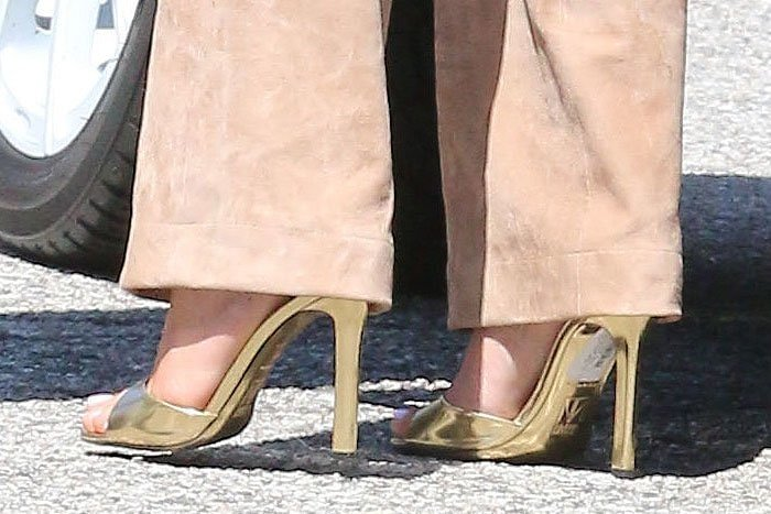 Tamara Mellon Whisper sandals with the stickers still on them on Kylie Jenner