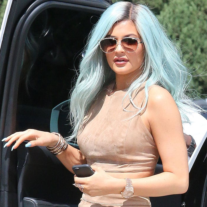Kylie Jenner stepping down from her white Range Rover