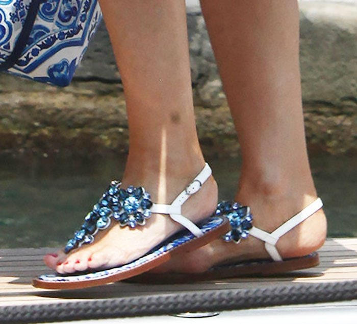 Kylie Minogue shows off her red toenails in a pair of blue-and-white Dolce & Gabbana sandals