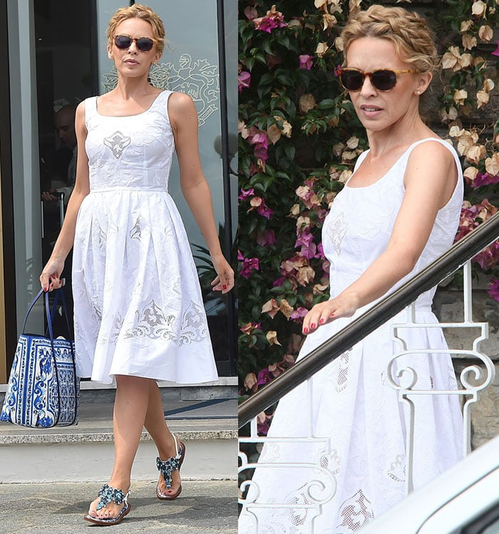 Kylie Minogue showcases her blue-and-white Dolce & Gabbana look as she boards a yacht