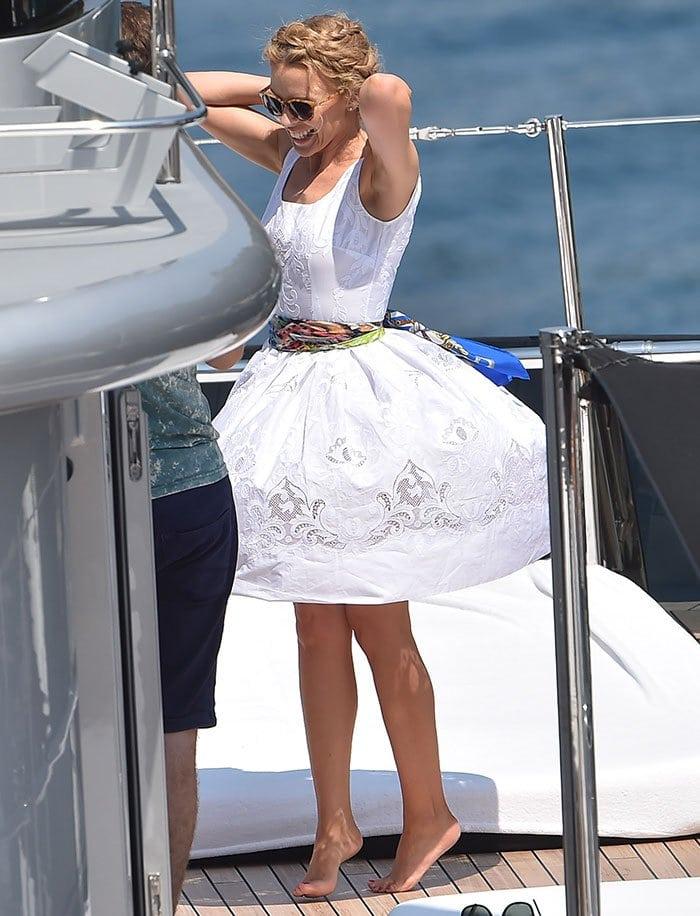 Kylie Minogue twirls around barefoot on board a yacht in Portofino