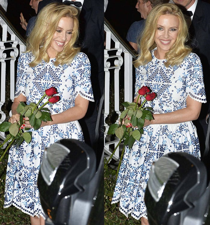 Kylie Minogue's blonde hair was worn down with a deep side parting