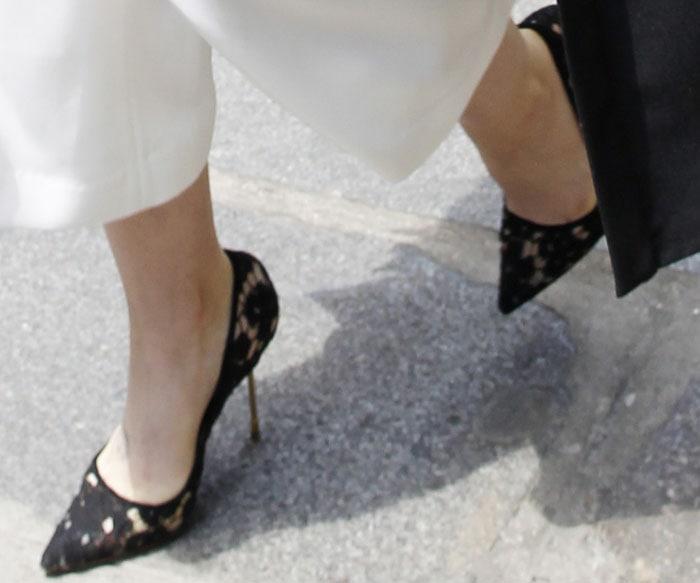 Lily Collins wears black lace Kurt Geiger heels