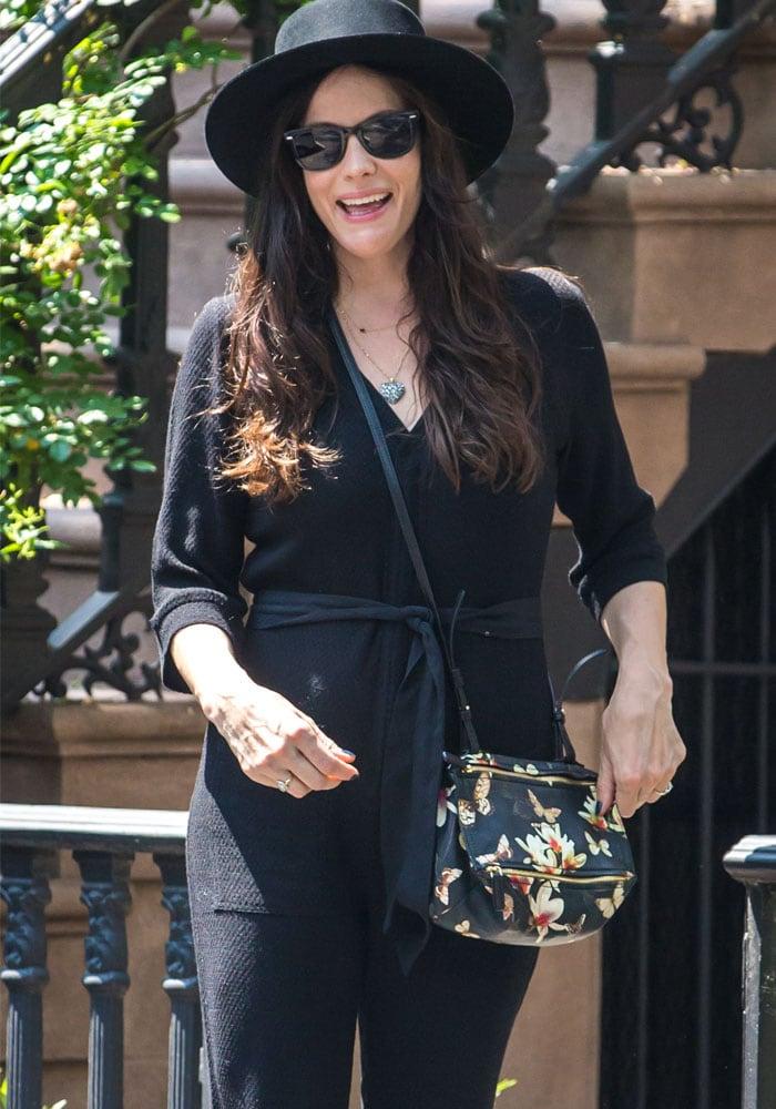 Liv Tyler's black wide-brim hat