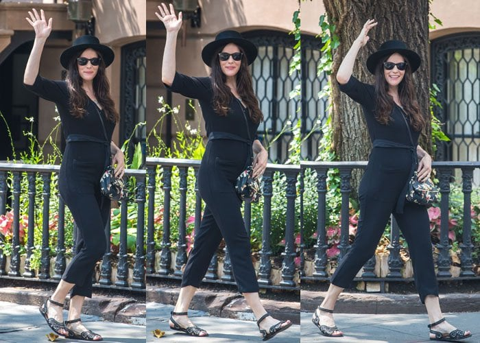 Liv Tyler rocked a cropped jumpsuit and toted a floral handbag