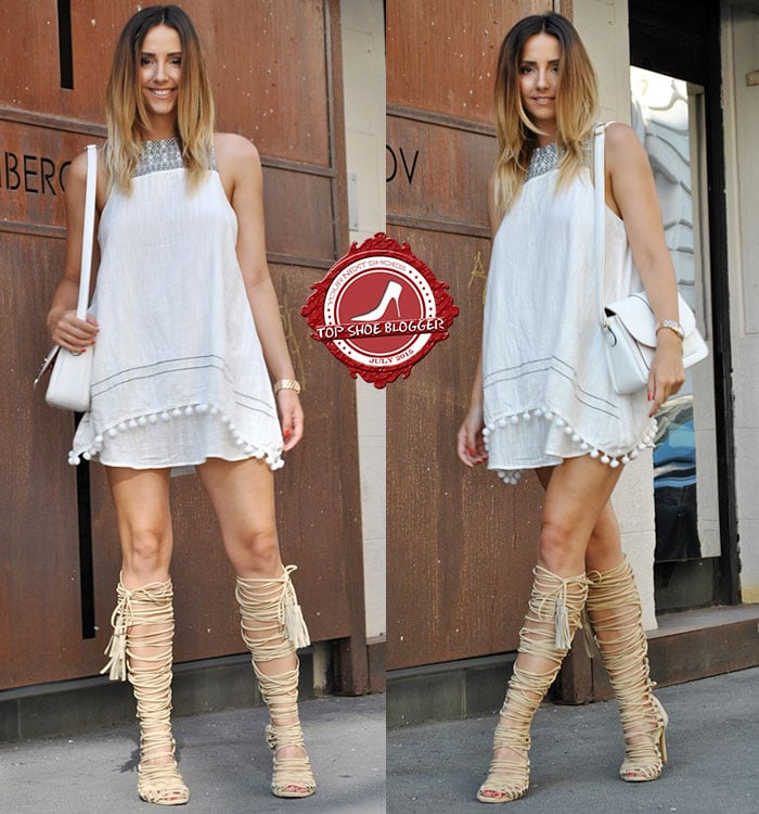 Manuella wore knee-high lace-up sandals with a white dress