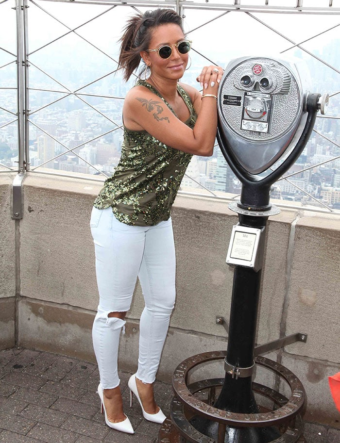 Mel B in a J. Crew green sequin tank top and white ripped jeans