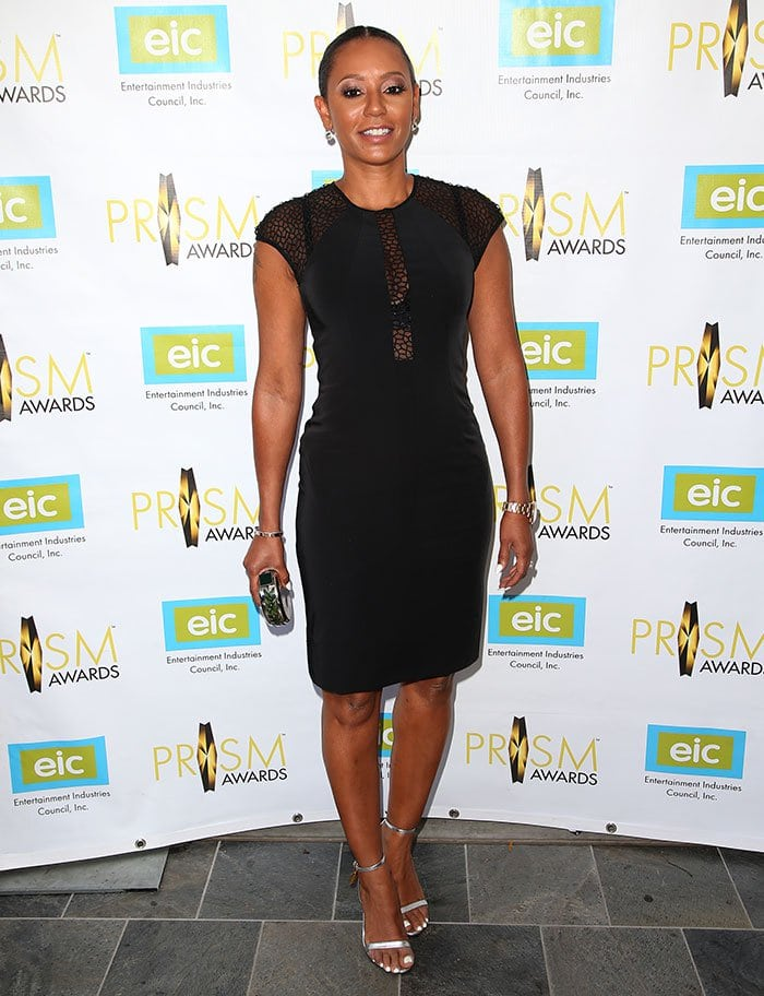Mel B. shows off her toned legs in a sexy — yet appropriate — little black dress that had cutouts in all the right places