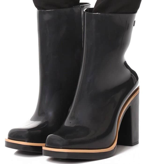 A chunky heel adds a sturdy lift to these glossy rubber Melissa rain booties