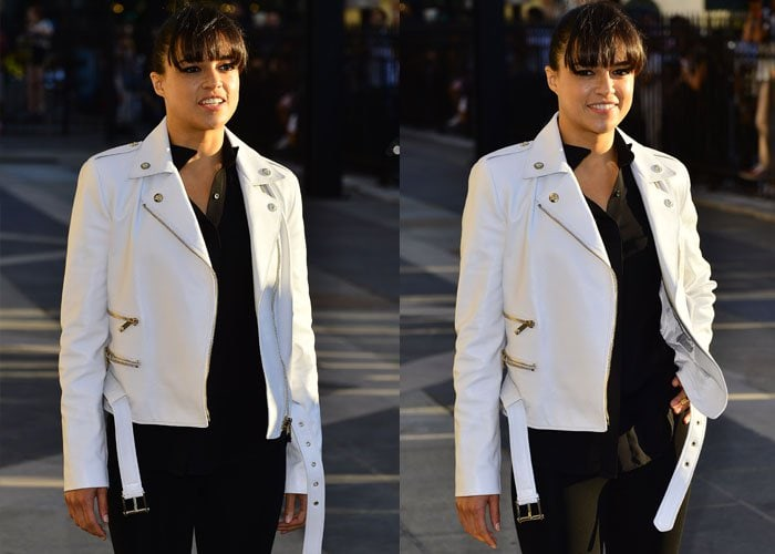 Michelle Rodriguez with a white leather jacket over her shoulders