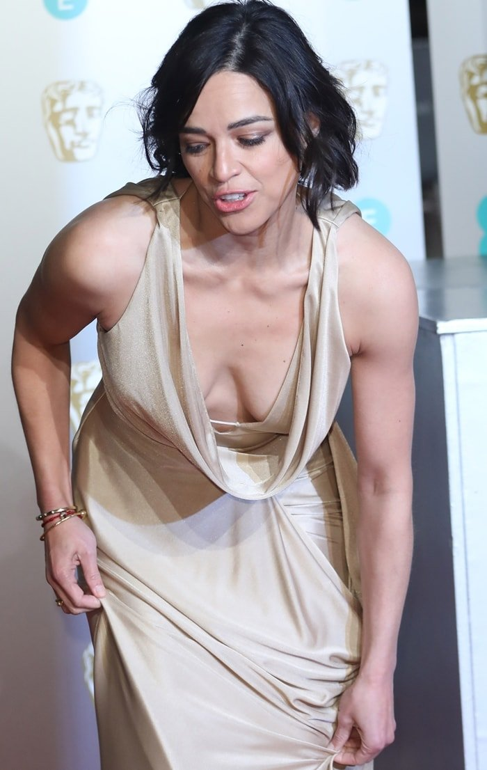 Michelle Rodriguez doing her best to prevent a nip slip