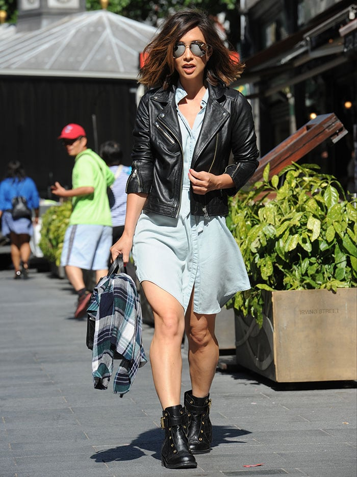 Myleene Klass paired a pale blue chambray shirt-dress with black biker boots