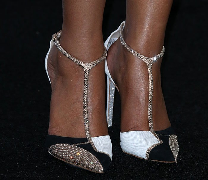 Nicki Minaj wearing Rene Caovilla pumps in white karung, black suede, and beige suede materials, embellished with sparkling Swarovski crystals