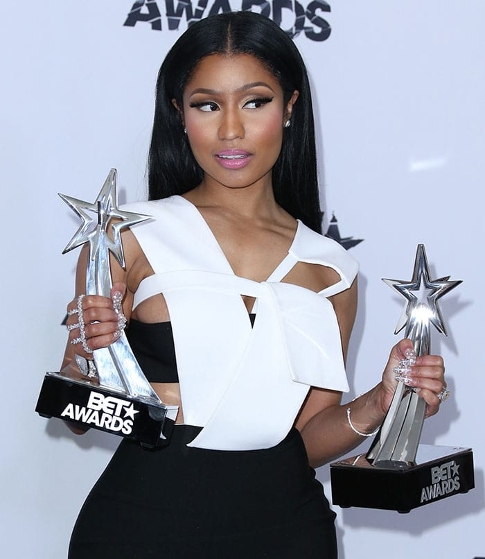 Nicki Minaj in a Mugler black-and-white sleeveless dress featuring a layered bodice with revealing cutouts and a fitted skirt