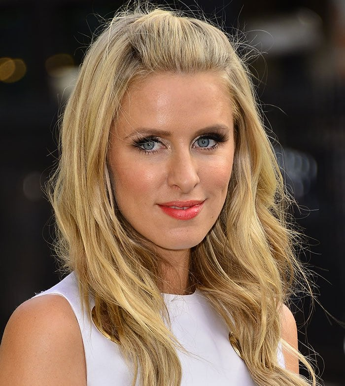 Nicky Hilton wore her blonde tresses down in loose waves, which framed her flawlessly made-up face