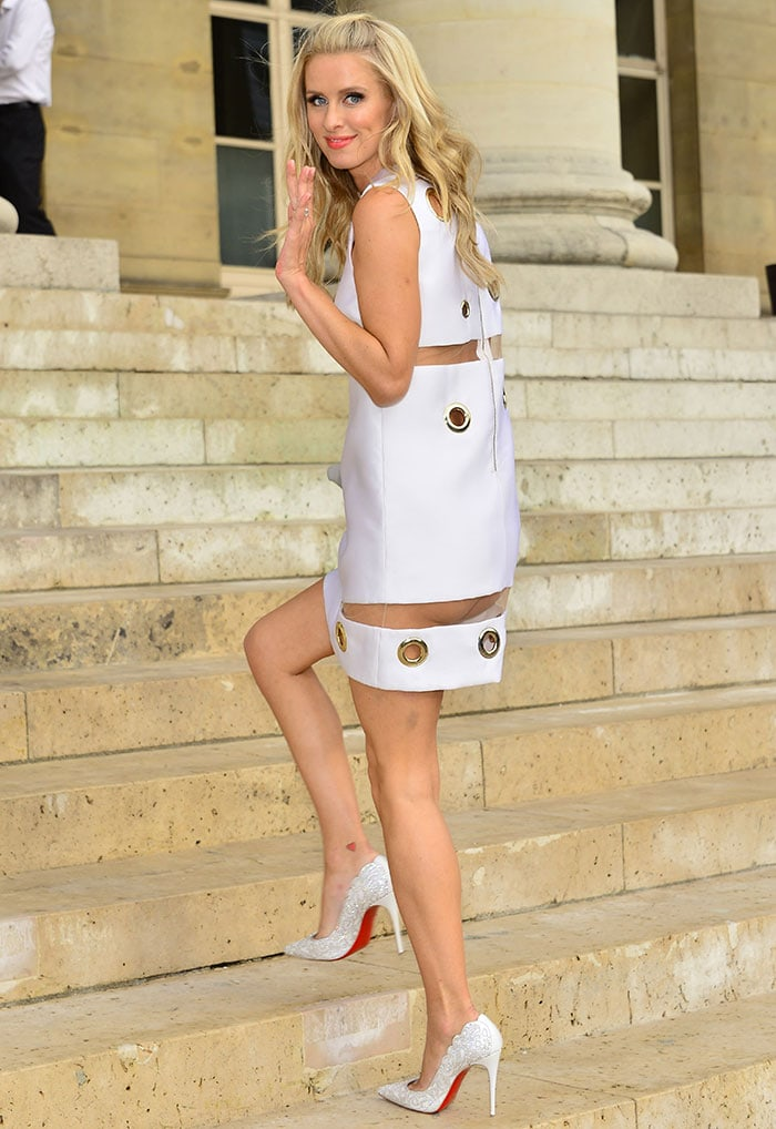 Nicky Hilton showing some serious underbutt in a quirky white Versace dress