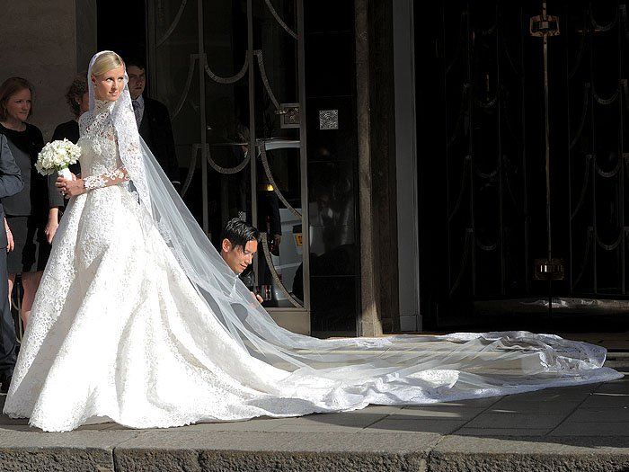 Nicky Hilton in her Valentino Couture wedding gown made of guipure lace, embellished with crystals, and topped off with a 3 meter long train
