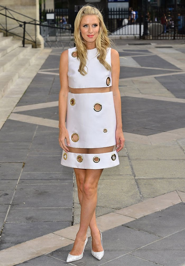 Nicky Hilton's dress features gold-trimmed circular cutouts in varying sizes and see-through sheer panels under the bust and at the bottom