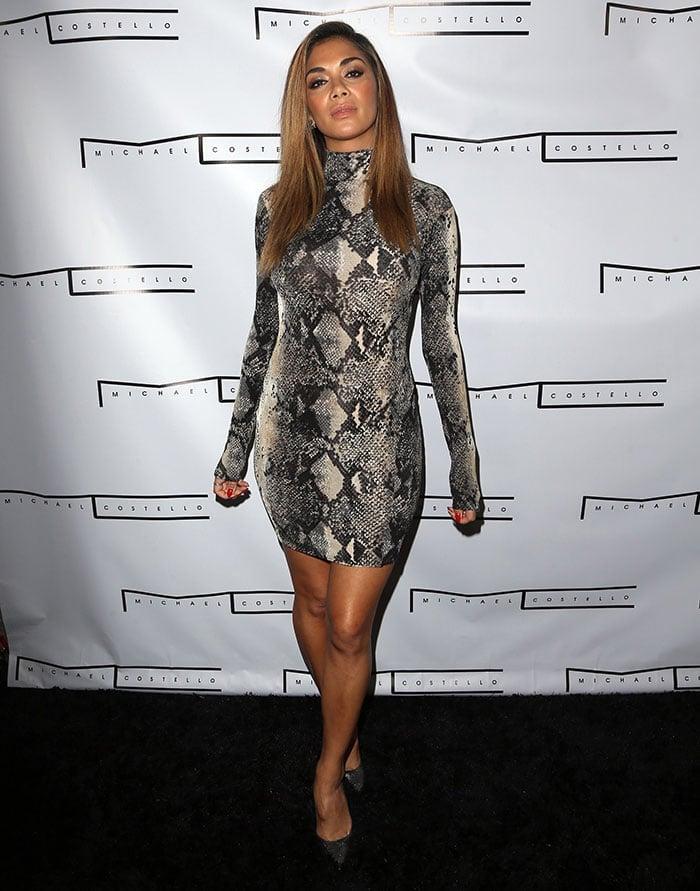 Nicole Scherzinger flaunted her long legs in a skintight snakeskin mini dress