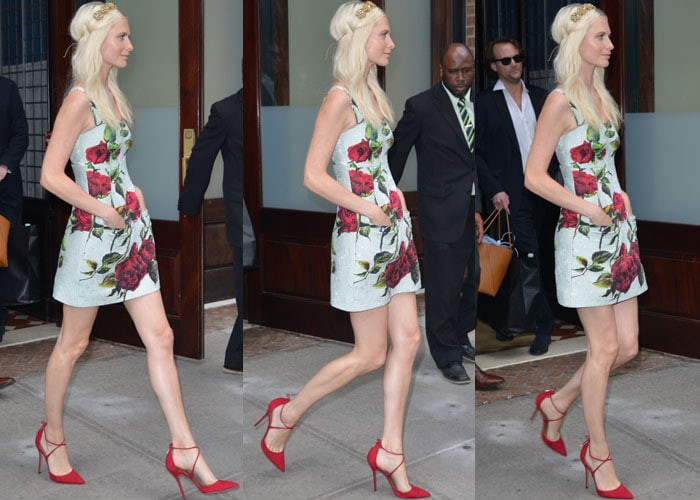 Poppy Delevingne paraded her legs in a fitted floral dress by Dolce & Gabbana
