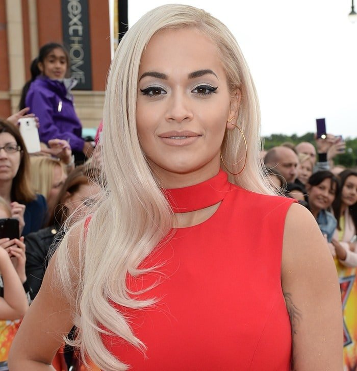 Rita Ora was a smokeshow in red with perfect winged eyeliner as she attended the X Factor photo call at Event City in Trafford Park, Manchester, England on July 8, 2015