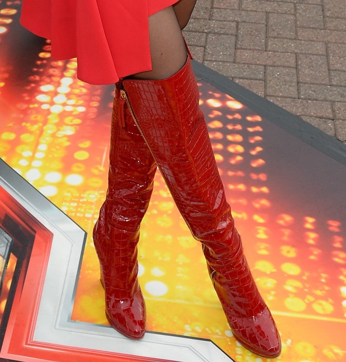 Rita Ora shows off her thigh-high red crocodile-patterned stripper boots
