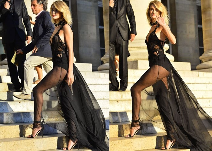 Rosie Huntington-Whiteley waves and shows off her model body in a sheer all-black outfit