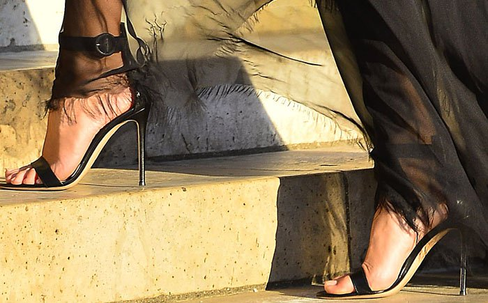 Rosie Huntington-Whiteley showed off her pedicure in a pair of strappy black Gianvito Rossi sandals