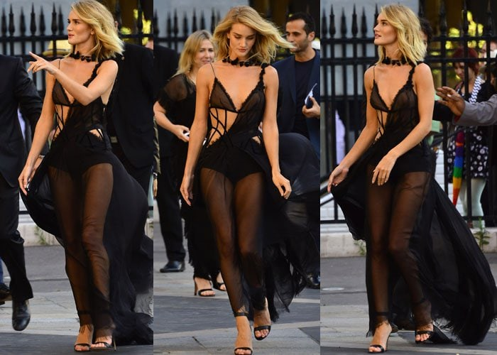 Rosie Huntington-Whiteley was all confidence as she showed off her leggy blonde figure in her sheer black Versace creation