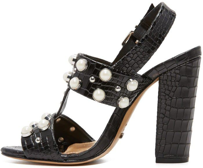 Imitation pearl studs complete the opulent look of these croc-embossed Schutz sandals